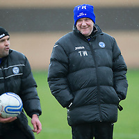 St Johnstone manager Tommy Wright pictured all smiles during training this morning, despite the atrocious weather, ahead of Saturday's League Cup semi-final against Aberdeen, also pictured is saints assistant boss Callum Davidson...28.01.14<br /> Picture by Graeme Hart.<br /> Copyright Perthshire Picture Agency<br /> Tel: 01738 623350  Mobile: 07990 594431