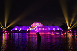 © Licensed to London News Pictures. 21/11/2017. London, UK. Lasers fill the sky above the Palm House to herald the opening of Christmas at Kew at Royal Botanical Gardens, Kew. The spectacular displays are illuminated by over one million tiny twinkling lights placed all over Kew Gardens - open Wednesdays – Sundays from 22 November 2017 – 2 January 2017. London, UK. Photo credit: Ray Tang/LNP