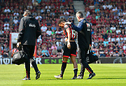 Junior Stanislas (19) of AFC Bournemouth looks dejected as he limps off injured and is replaced by Jack Simpson (25) of AFC Bournemouth during the Premier League match between Bournemouth and Fulham at the Vitality Stadium, Bournemouth, England on 20 April 2019.