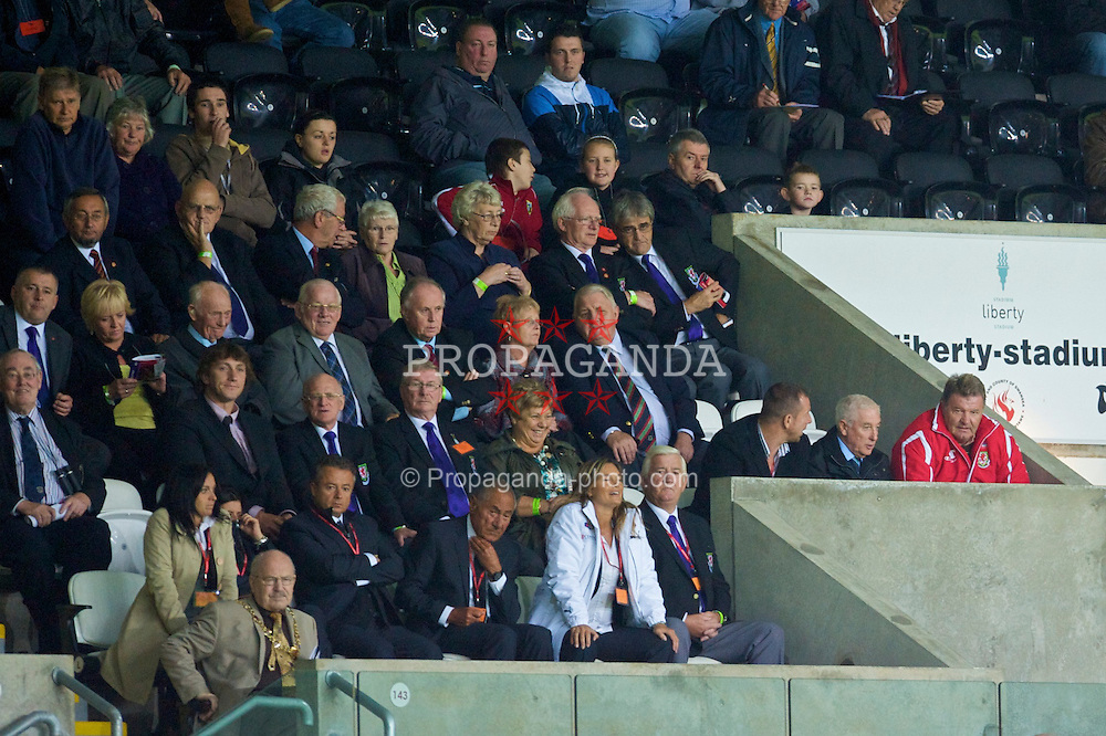 SWANSEA, ENGLAND - Friday, September 4, 2009: Wales' manager John Toshack MBE and assistant Roy Evans watch during the UEFA Under 21 Championship Qualifying Group 3 victory over Italy with FAW council members at the Liberty Stadium. Also new FAW President Phil Pritchard. (Photo by David Rawcliffe/Propaganda)