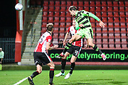 Forest Green Rovers Christian Doidge(9) heads the ball saved by Cheltenham Town goalkeeper Jon Flatt(1)] during the EFL Trophy match between Cheltenham Town and Forest Green Rovers at Whaddon Road, Cheltenham, England on 3 October 2017. Photo by Shane Healey.