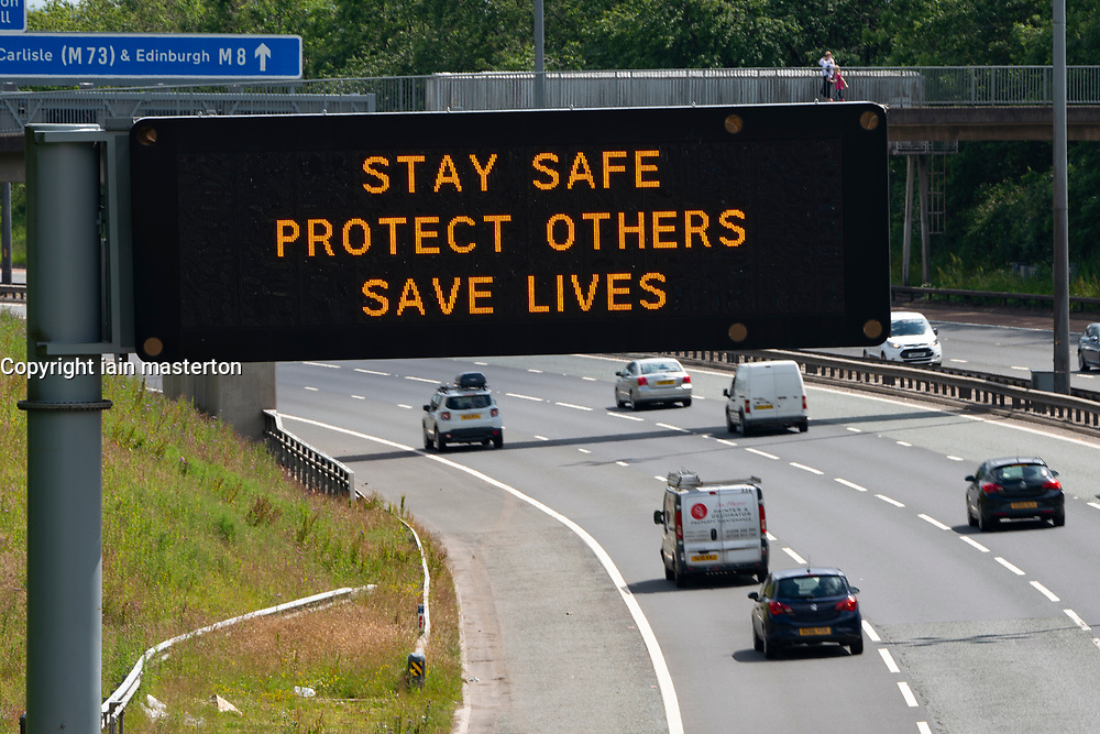Glasgow and Haggs, Scotland, UK. 20 June, 2020. Variable message boards beside M8 motorway in Glasgow and  M80 motorway in central Scotland with new official government health advice about how to tackle the covid-19 and coronavirus pandemic. Stay Safe, Protect Others, Saves Lives is the new slogan.  Pictured; Display beside M8 in Glasgow.  Iain Masterton/Alamy Live News