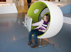 Young girl visitor using multimedia area at Humboldt Box visitors center at Lustgarten on Unter den Linden Mitte Berlin