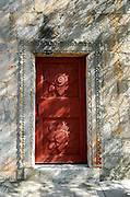 Detail of carved wooden door, Franciscan monastery and church, island of Badija, Croatia