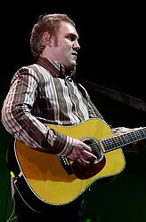 David Grey plays a Concert to a sellout Sheffield Hallam FM Arena  November 29 2002 Friday<br /><br />Copyright Paul David Drabble<br />Freelance Photographer<br />07831 853913<br />0114 2468406<br />www.pauldaviddrabble.co.uk<br /> [#Beginning of Shooting Data Section]<br />Nikon D1 <br /> 2002/11/29 21:55:00.1<br /> JPEG (8-bit) Fine<br /> Image Size:  2000 x 1312<br /> Color<br /> Lens: 80-200mm f/2.8-2.8<br /> Focal Length: 120mm<br /> Exposure Mode: Manual<br /> Metering Mode: Spot<br /> 1/125 sec - f/2.8<br /> Exposure Comp.: 0 EV<br /> Sensitivity: ISO 400<br /> White Balance: Auto<br /> AF Mode: AF-S<br /> Tone Comp: Normal<br /> Flash Sync Mode: Not Attached<br /> Color Mode: <br /> Hue Adjustment: <br /> Sharpening: Normal<br /> Noise Reduction: <br /> Image Comment: <br /> [#End of Shooting Data Section] David Grey plays a Concert to a sell out Sheffield Hallam FM Arena November 29 2002 Friday<br /> <br /> Copyright Paul David Drabble<br /> Freelance Photographer<br /> 07831 853913<br /> 0114 2468406