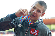 Pawel Wojciechowski from Poland poses and bites his silver medal in men's pole vault while medal ceremony during the Fifth Day of the European Athletics Championships Zurich 2014 at Letzigrund Stadium in Zurich, Switzerland.<br /> <br /> Switzerland, Zurich, August 16, 2014<br /> <br /> Picture also available in RAW (NEF) or TIFF format on special request.<br /> <br /> For editorial use only. Any commercial or promotional use requires permission.<br /> <br /> Photo by © Adam Nurkiewicz / Mediasport