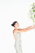 Woman in evening dress accepts a bouquet of white flowers