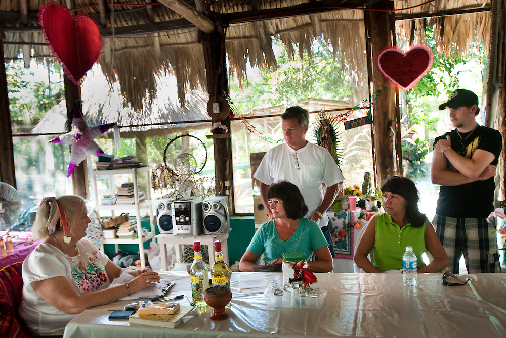 Sandra Dayton, owner of the Jungle Spa explaining mayan massage to a group of american guests from upstate New York...The Jungle Spa in Puerto Morelos, Mexico, just 20 minutes from Cancun is managed by Sandra Dayton who is also the co-founder of the non-profit organization Lu'um K'aa Nab that helps mayan women make a living for them selves by selling handicraft and giving mayan massage at the Jungle Spa.