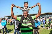 Forest Green Rovers Shamir Mullings(18) with his daughter during the Vanarama National League Play Off second leg match between Forest Green Rovers and Dagenham and Redbridge at the New Lawn, Forest Green, United Kingdom on 7 May 2017. Photo by Shane Healey.