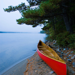 A canoe on the shoreline of Seboeis Lake near Millincoket, Maine.