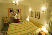 Passengers staying at the original Staterooms give a champagne reception for the others.