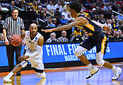 SAN DIEGO, CA - MARCH 16:  West Virginia Mountaineers guard Jevon Carter (2) dribbles against Murray State Racers guard Ja Morant (12) during a first round game of the Men's NCAA Basketball Tournament at Viejas Arena in San Diego, California. West Virginia won 85-68.  (Photo by Sam Wasson)