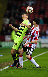 Yeovil Town's Kevin Dawson wins the header against Sheffield United's Jamie Murphy - Photo mandatory by-line: Dougie Allward/JMP - Tel: Mobile: 07966 386802 03/05/2013 - SPORT - FOOTBALL - Bramall Lane - Sheffield - Sheffield United V Yeovil Town - NPOWER LEAGUE ONE PLAY-OFF SEMI-FINAL FIRST LEG