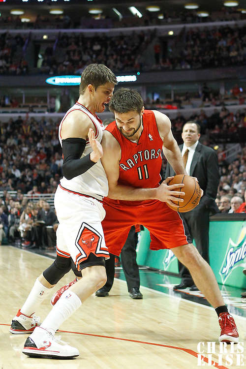 24 March 2012: Chicago Bulls shooting guard Kyle Korver (26) defends on Toronto Raptors small forward Linas Kleiza (11) during the Chicago Bulls 102-101 victory in overtime over the Toronto Raptors at the United Center, Chicago, Illinois, USA.