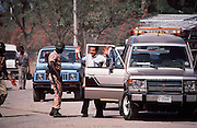 A Haitian soldier questions a motorist at a checkpoint in Port au Prince prior to elections in 1988.
