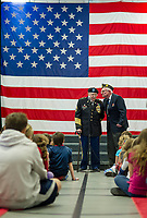 Master Sergeant Retired Elliot Finn and American Legion Commander Robert Kennelly address Interlakes students, faculty and family during Friday mornings Veteran's Day assembly.  (Karen Bobotas/for the Laconia Daily Sun)