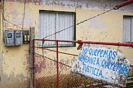 Gate and CDR sign in Las Pozas, Pinar del Rio, Cuba.
