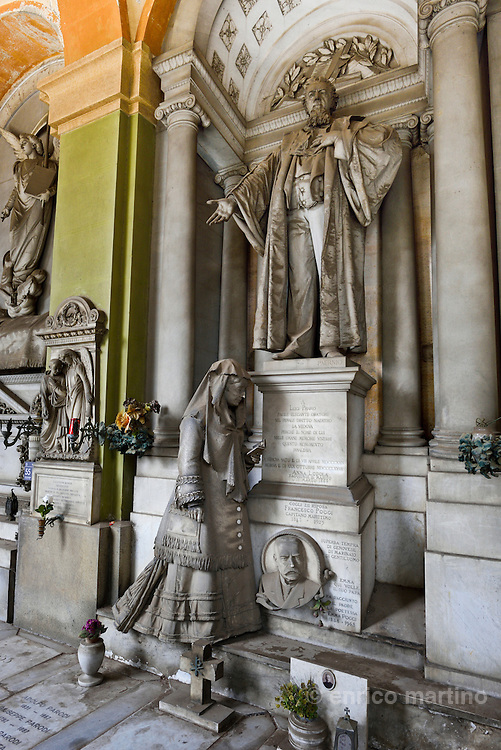 Genoa.  The Cimitero monumentale di Staglieno is famous for its monumental sculpture. Tomba Priario by Demetrio Paernio 1881. Covering an area of more than a square kilometre, it is one of the largest cemeteries in Europe.
