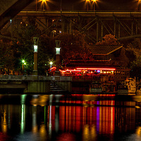 Calhoun's on the River in Knoxville, Tennessee reflects in the waters of the Tennessee River.