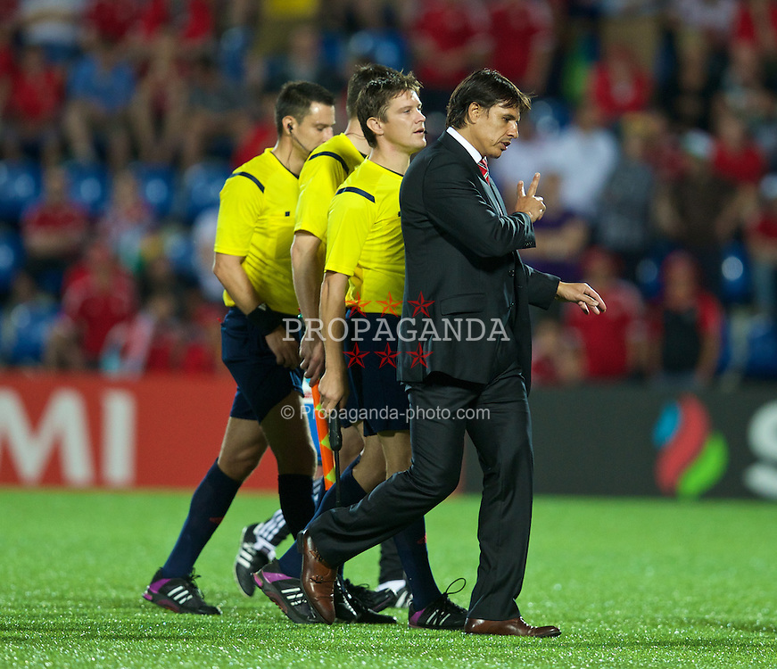 ANDORRA LA VELLA, ANDORRA - Tuesday, September 9, 2014: Wales' manager Chris Coleman argues with referee Slavko Vincic during the opening UEFA Euro 2016 qualifying match against Andorra at the Camp d'Esports del M.I. Consell General. (Pic by David Rawcliffe/Propaganda)