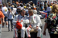"MONTEREY, CA - AUGUST 18:  Race legends Johnny Rutherford (L) and Bobby Unser (R) ride to their cars to race in the ""Race of Legends"" at  the Monterey Historic Automobile Races at the Mazda Raceway Laguna Seca on August 18, 2007 in Monterey, California.  (Photo by David Paul Morris)"