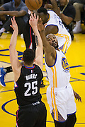 Golden State Warriors forward Kevin Durant (35) attempts to block a shot by LA Clippers guard Austin Rivers (25) at Oracle Arena in Oakland, Calif., on February 23, 2017. (Stan Olszewski/Special to S.F. Examiner)