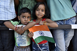 October 21, 2018 - Guwahati, Assam, India - Indian team supporter kids holding Indian flag outside the Barsapara Cricket Stadium in the day of India vs West Indies one day international  cricket match in Guwahati, Assam, India on Sunday, October 21, 2018. (Credit Image: © David Talukdar/NurPhoto via ZUMA Press)