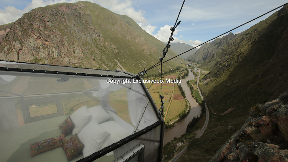 Terrifying See-Through Sleeping Capsules Hang 400 Feet Above Peru's Sacred Valley<br /> <br /> Thrill-seeking travelers can now stay in Skylodge, a trio of transparent pods placed 400 feet (122m) above the ground on a cliff-face in the Peruvian Andes.<br /> Located near the city of Cuzco, the three 24 x 8 meter capsules, made from polycarbonate and aluminium, are operated by Peruvian tour company Natura Viva and overlook the spectacular Sacred Valley – a region renowned for its breathtaking scenery, small villages and death-defying roads.<br /> The price you'll have to pay to stay in one of these incredibly unique capsules, is having to climb a 400-foot steel ladder embedded in the almost sheer-cliff face to get to one of these unique hotels. If you don't fancy that, you can also hike or use a zip-wire. Oh, and the other price you'll have to pay is approximately $300 USD.<br /> ©Natura Viva/Exclusivepix Media