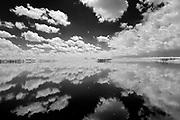 Clouds reflected in wetland<br />Oyen<br />Alberta<br />Canada