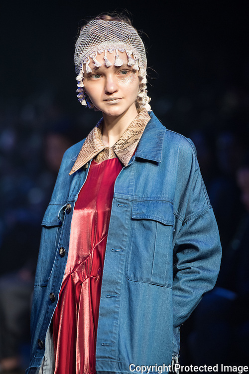 OCTOBER 21: A model  presents the Murrai collection at the Amazon Fashion Week Tokyo's 2017 Spring/Summer show under way at Shibuya Hikarie in Tokyo on Oct. 21, 2016. and other locations through 23rd. Nearly 50 fashion brands and companies will hold their shows at several locations through 23rd.. 21/10/2016-Tokyo, JAPAN