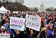 Marching in front of The Capitol.<br /> Women march on Washington to protest the Trump presidency and support women's rights.<br /> The march had a massive turnout, a day after the Trump inauguration