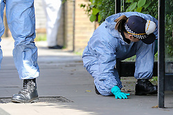 © Licensed to London News Pictures. 12/05/2019. London, UK. Forensics officers on Tollington Road, Islington in north London as Met police launch an investigation into the death of a man who was found in a wheelie bin behind a Waitrose store, at the junction of Annette Road, shortly before 4pm on Saturday 11 May 2019. Photo credit: Dinendra Haria/LNP