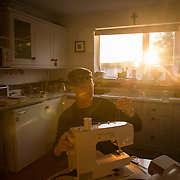 Hermit Sister Rachel Denton uses her sewing machine at St Cuthberts' Hermitage in Lincolnshire, north east Britain September 25, 2015. Sister Rachel Denton has vowed to spend the rest of her life living as a consecrated hermit in the Catholic faith. A hermit is a person who chooses to live alone, with the intention of finding God. Rarely leaving her house she lives a life of prayer and solitude. However, she uses the internet and social media to share her experience and distance her self from physically interacting with society. REUTERS/Neil Hall