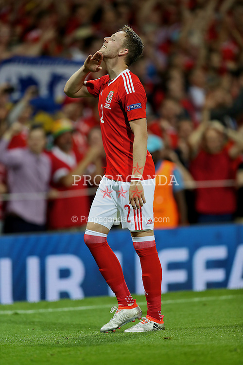 TOULOUSE, FRANCE - Monday, June 20, 2016: Wales' Chris Gunter celebrates the 3-0 victory over Russia and reaching the knock-out stage during the final Group B UEFA Euro 2016 Championship match at Stadium de Toulouse. (Pic by David Rawcliffe/Propaganda)