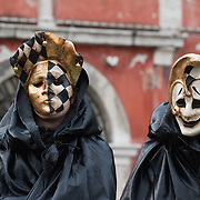 VENICE, ITALY - FEBRUARY 20:  Two people wearing Carnival costumes and masks pose in Cannaregio on February 20, 2011 in Venice, Italy. The Venice Carnival, one of the largest and most important in Italy, attracts thousands of people from around the world each year. The  theme for this year's carnival is Ottocento amd Sissi, a nineteenth century evocation, and will run from February 19 till March 8.