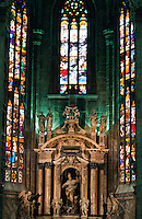 Milan, Italy, Duomo Cathedral. Stained glass windows in a side chapel.