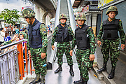 29 MAY 2014 - BANGKOK, THAILAND: Thai soldiers block access to the escalator that goes to the BTS Skytrain station in Victory Monument. After a series of protests around Victory Monument earlier in the week, the Thai army Thursday shut down vehicle access to the area, one of the main intersections in Bangkok, and kept people out of the area. Thousands of soldiers surrounded the Monument and effectively locked the area down. There were no protests at Victory Monument for the first time in the week since the coup deposed the elected civilian government.   PHOTO BY JACK KURTZ