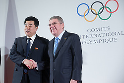 LAUSANNE, Jan. 20, 2018  International Olympic Committee (IOC) President Thomas Bach (R) shakes hands with Kim Il Guk, the president of the Olympic Committee of the Democratic People's Republic of Korea (DPRK) in Lausanne, Switzerland, on Jan. 20, 2018. (Credit Image: © Xu Jinquan/Xinhua via ZUMA Wire)