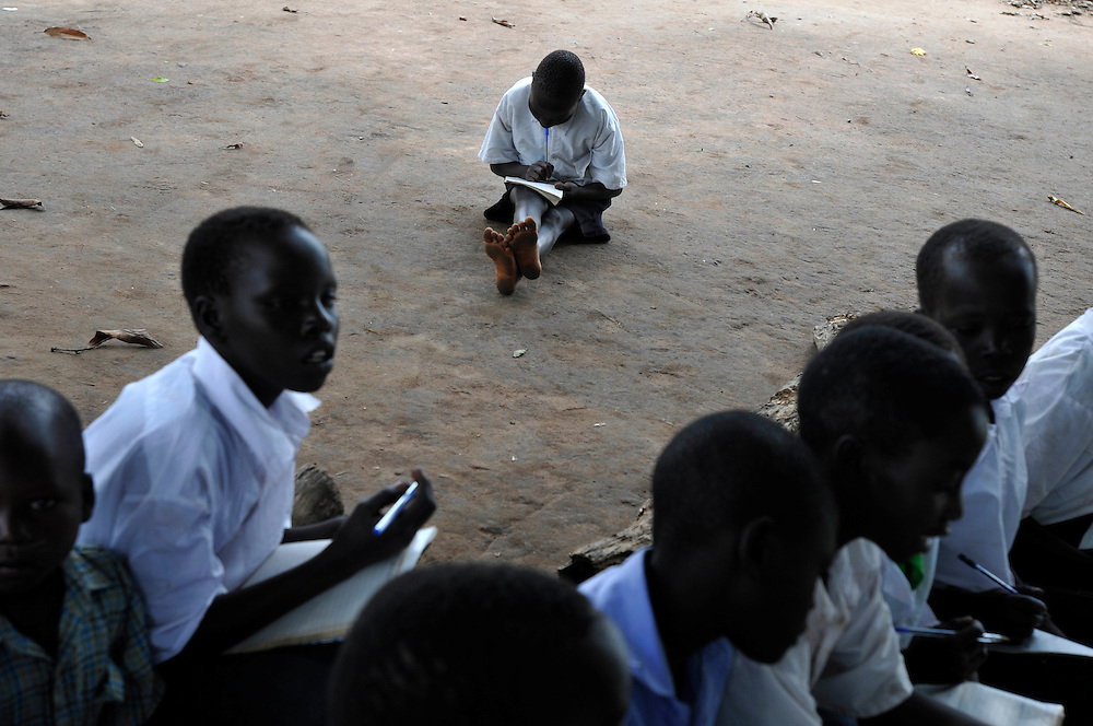 School children at an outdoor class under a mango tree..Morobo, South Sudan. 24/06/2011..Photo © J.B. Russell