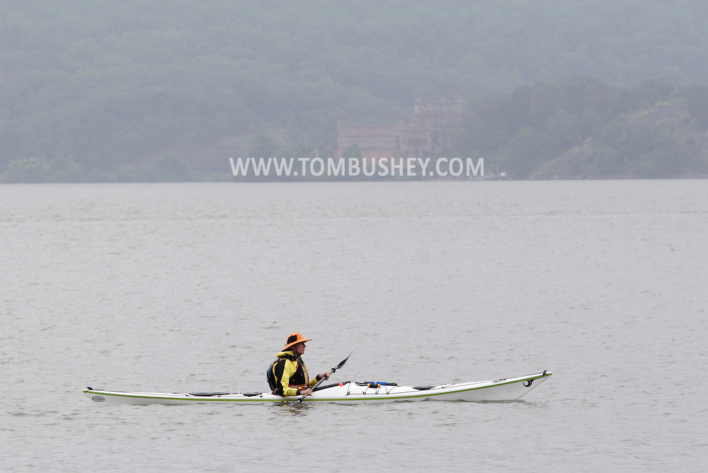 New Windsor, New York - A kayaker paddles on the Hudson River at the Paddlefest event sponsored by the Mid-Hudson Chapter of the Adirondack Mountain Club at Kowawese Unique Area at Plum Point on  Sunday, June 13, 2010. Bannerman Castle at Pollepel Island is in the background.