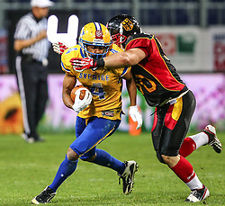 03.06.2014, NV Arena, St. Poelten, AUT, American Football Europameisterschaft 2014, Gruppe A, Schweden (SWE) vs Deutschland (GER), im Bild Amat Jobe, (Team Sweden, WR, #4) und Kerim Homri, (Team Germany, LB, #50) // during the American Football European Championship 2014 group A game between Sweden vs Germany at the NV Arena, St. Poelten, Austria on 2014/06/03. EXPA Pictures © 2014, PhotoCredit: EXPA/ Thomas Haumer