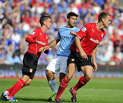 Manchester City's Sergio Aguero is outnumbered  - Photo mandatory by-line: Joe Meredith/JMP - Tel: Mobile: 07966 386802 25/08/2013 - SPORT - FOOTBALL - Cardiff City Stadium - Cardiff -  Cardiff City V Manchester City - Barclays Premier League