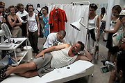 """VENICE, ITALY..June 1999..48th Biennale of Venice.Slovak pavillion..Project """"Slovak Art for Free"""": complimentary instant tattoos with designs by 46 contemporary Slovak artists, curated by Petra Hana?kova and Alexandra Kusa?..(Photo by Heimo Aga)"""