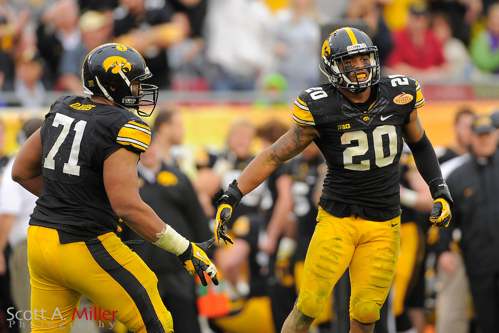 Iowa Hawkeyes linebacker Christian Kirksey (20) during the LSU Tigers 21-14 win over the Hawkeyes in the 2014 Outback Bowl at Raymond James Stadium January 1, 2014 in Tampa, Florida.      <br /> <br />  &copy; 2014 Scott A. Miller