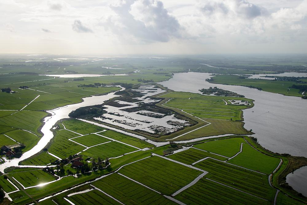 Nederland, Friesland, Alde Feanen, 10-10-2014; It Eilân, ten zuiden van Sytebuorren. Voormalig landbouwgebied (melkveehouderij), nu weidevogelgebied en retentiepolder. Rechts aan de horizon Grouw.<br /> The old peatlands, Frisian peatland and bog, nature reserve.<br /> luchtfoto (toeslag op standard tarieven);<br /> aerial photo (additional fee required);<br /> copyright foto/photo Siebe Swart