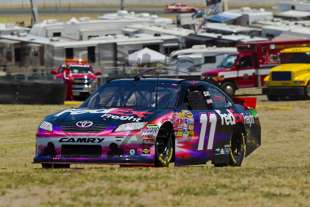 Sonoma, CA - June 24, 2011:  Denny Hamlin (11) brings his race car through the turns during a practice session for the Toyota/Save Mart 350 race at the Infineon Raceway in Sonoma, CA.