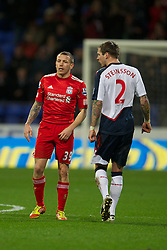 BOLTON, ENGLAND - Saturday, January 21, 2011: Liverpool's Craig Bellamy has words with Bolton Wanderers' Gretar Rafn Steinsson during the Premiership match at the Reebok Stadium. (Pic by David Rawcliffe/Propaganda)
