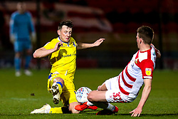 Ollie Clarke of Bristol Rovers tackles Paul Downing of Doncaster Rovers - Mandatory by-line: Robbie Stephenson/JMP - 26/03/2019 - FOOTBALL - Keepmoat Stadium - Doncaster, England - Doncaster Rovers v Bristol Rovers - Sky Bet League One