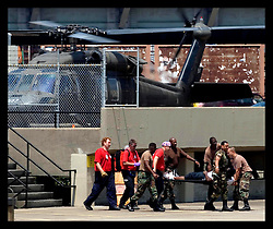 30th August, 2005. Triage at the Superdome in New Orleans. Army medevacs unload an injured man saved from the catastrophic floods.