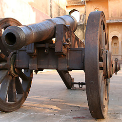 Vintage Indian artillery piece at Nahargarh Fort, overlooking the pink city of Jaipur in the Indian state of Rajasthan.